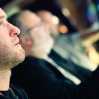 Man at a slot machine.