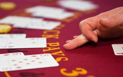 Dealers hand on a blackjack table