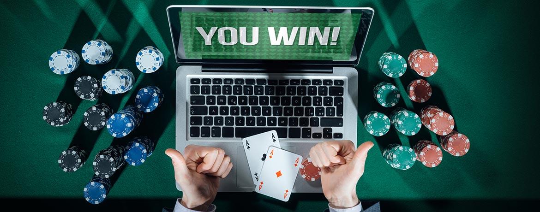 """Laptop screen reads """"You Win!"""""""