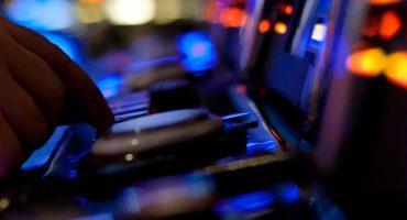 Hand pushing button on slot machine